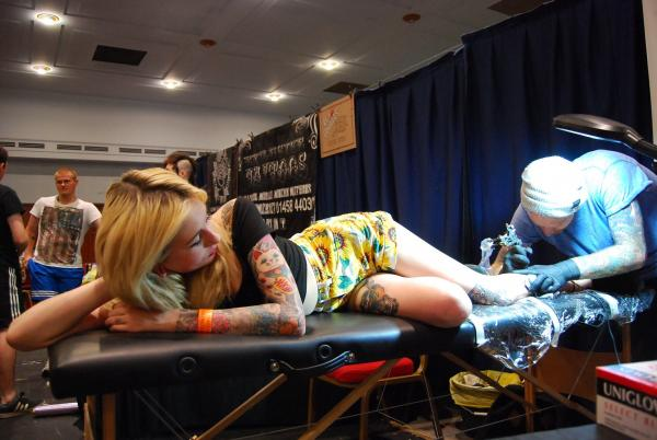 Southampton teenager Molly McDermott gets a tattoo by Ginger Tom's Tattoo Studio