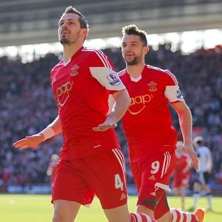 Daily Echo: Southampton chairman Ralph Krueger has said neither Morgan Schneiderlin, left, nor Jay Rodriguez will be leaving St Mary's