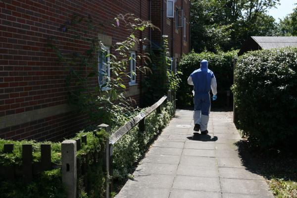 A forensic team enters the cordoned-off flat in Westcliff Mews, Southampton