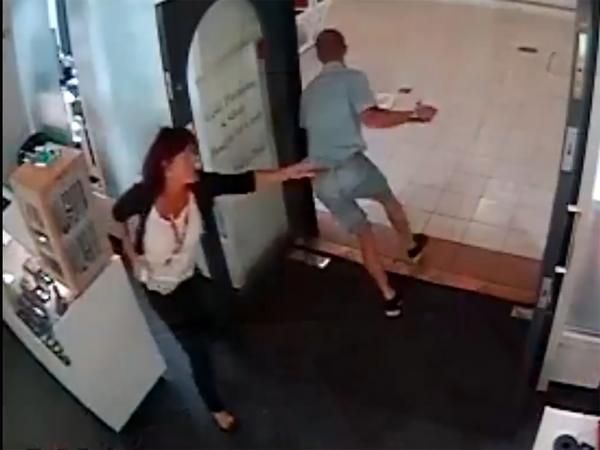 Diane Devonshire attempts to stop the thief leaving the shop