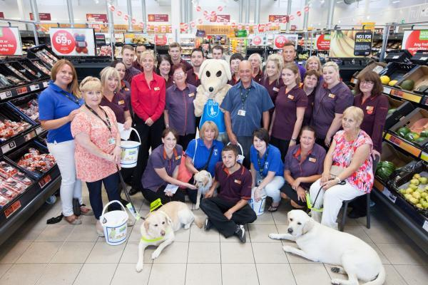 Sainsbury's staff with members of Southampton Mobility Guide Dogs