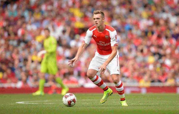 DEPARTURE: Calum Chambers on his Arsenal debut against Benfica
