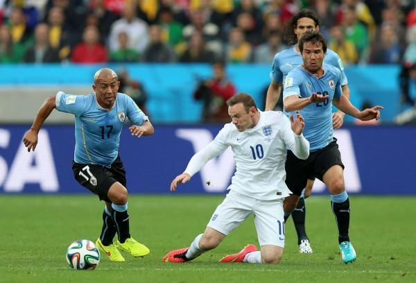 Alvaro Gonzalez (right) in World Cup action against England