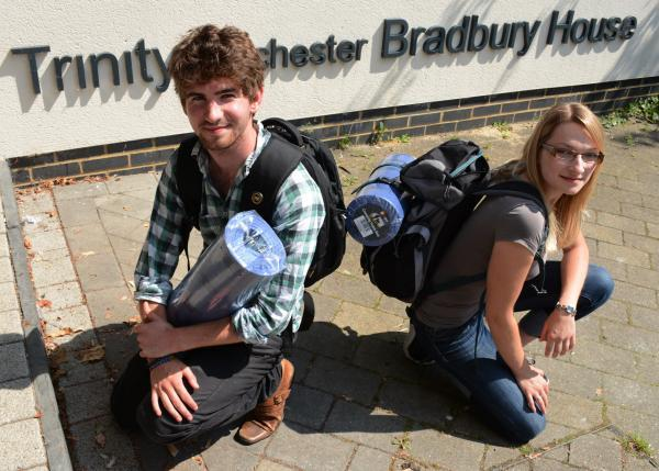 Wincester University Rotaract members Luke Addison and Irina Wickel with the backpacks that they will be giving to the homeless.