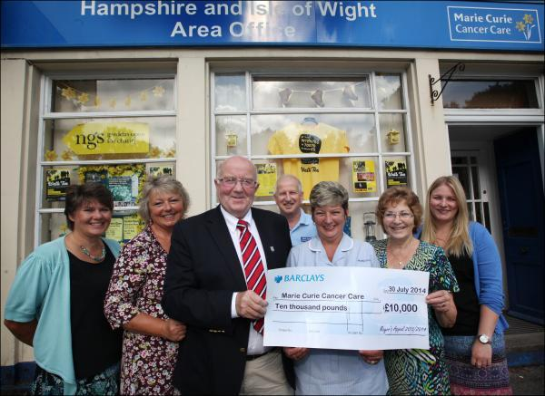 Eastleigh mayor Malcolm Cross presents the cheque to nurse Debbie Malaney, alongside Sandy Wright, Wendy Savage, Ray Fishman, former mayoress Sue Cross and Sally Sansome.