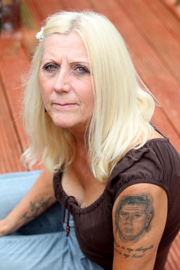 Mum's tattoo tribute for son one year after brutal killing