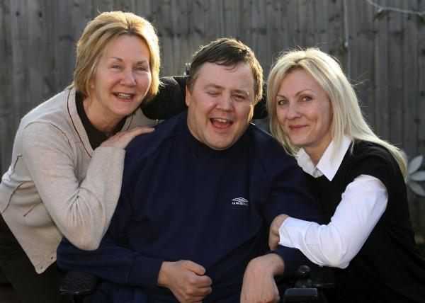 MAKING A DIFFERENCE: Wayne Howard with his mum Isobel and his partner Tracy Goodwin