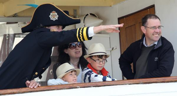 A family on the lookout from the SS Shieldhall at Southampton Maritime Festival