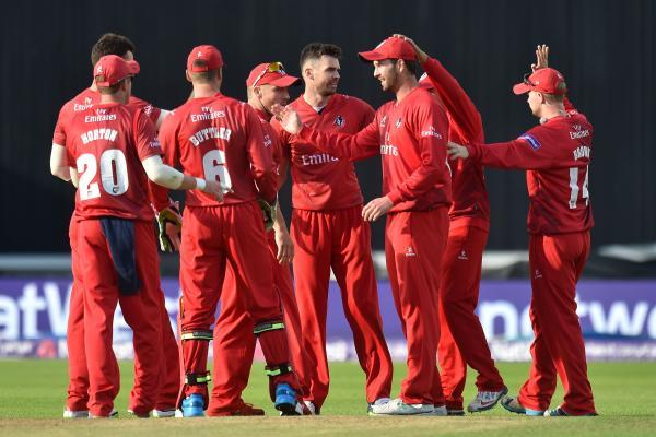 James Anderson celebrates the wicket of Jimmy Adams with his Lancashire teammates