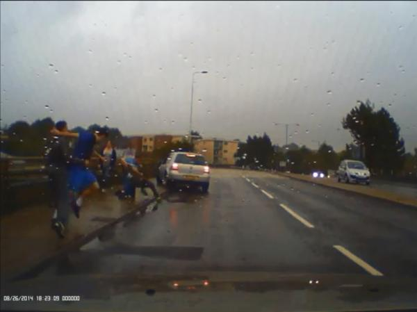 Police are appealing for information on the roadside brawl, pictured
