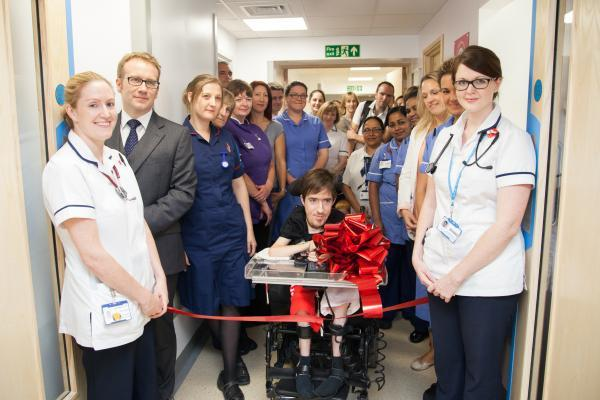 Patient George Baker, along with  members of hospital staff, opens the new respiratory high dependency unit at Southampton General Hospital.
