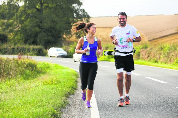 Francis Benali is joined by daughter Kenzie for part of his gruelling run to Kippax yesterday.