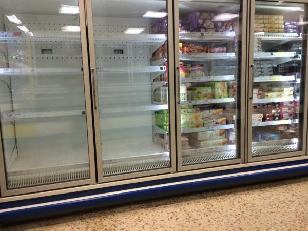 Empty freezer shelves in Tesco in Bursledon which is running out of ice as shoppers rush to complete the ice bucket challenge