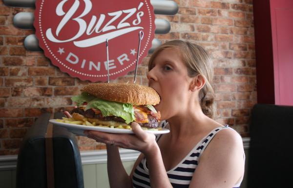 Size six waisted Emma Dalton conquered the Buzz's Diner burger challenge eating a 5,000 calorie meal in 37 minutes