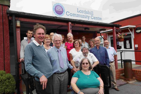 Cllr Simon Letts, front left and Lordshill Community Centre chairman Mike Holder with community centre users. Echo picture by Stuart Martin.