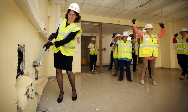 UHS Foundation Trust chief executive Fiona Dalton swings the sledgehammer as work gets under way on the new cardiac unit.