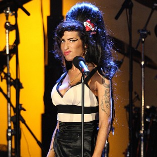 Amy Winehouse performs during the Hyde Park concert marking Nelson Mandela's 90th birthday