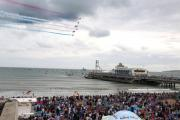 The Red Arrows fly over Bournemouth.