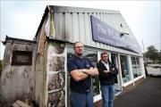 Woolston traders Steve Batten and Dean Cummins outside Steve's flooring company where there have been arson attacks