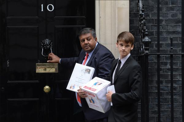 Sanjay Ganatra and Ethan Dallas deliver the petition to Downing Street.