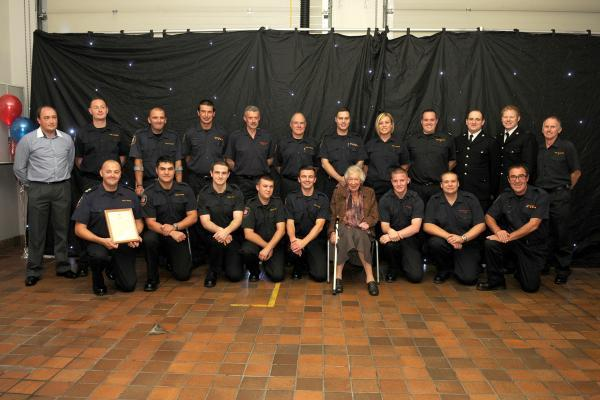 Elizabeth Sanger-Davies with firefighters and police officers who took part in the rescue.