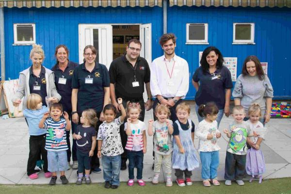 Tom Cook, fourth from left, and Gianmarco Fiorentino, third right, of Croma Security Systems with staff and children from Squirrels Corner Pre-school.