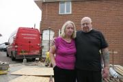 Sheila and Geoff Goff in front of the crash scene at their home in Midanbury, Southampton