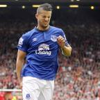 Daily Echo: Everton's Kevin Mirallas pulled up injured during the Merseyside derby