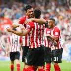Daily Echo: Onn song: Southampton's Graziano Pelle celebrates the fifth goal with key man Dusan Tadic against defeated Sunderland