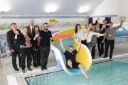 The keys to the newly-refurbished Oaklands Pool are handed by the city council to the new Oaklands Pool Community Group