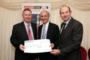 Daily Echo editor Ian Murray (right) presents the cheque to Lord Black of Brentwood (left) with Evening Standard managing editor Doug Wills