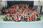Good report: Pupils at Romsey Primary School celebrate their Oftsted report and proudly wear their Christmas jumpers to raise money for Save the Children.