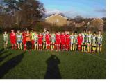 TRIBUTE: Players from Baddesley Park and Hiltingbury Hawks line up in tribute to the First World War.