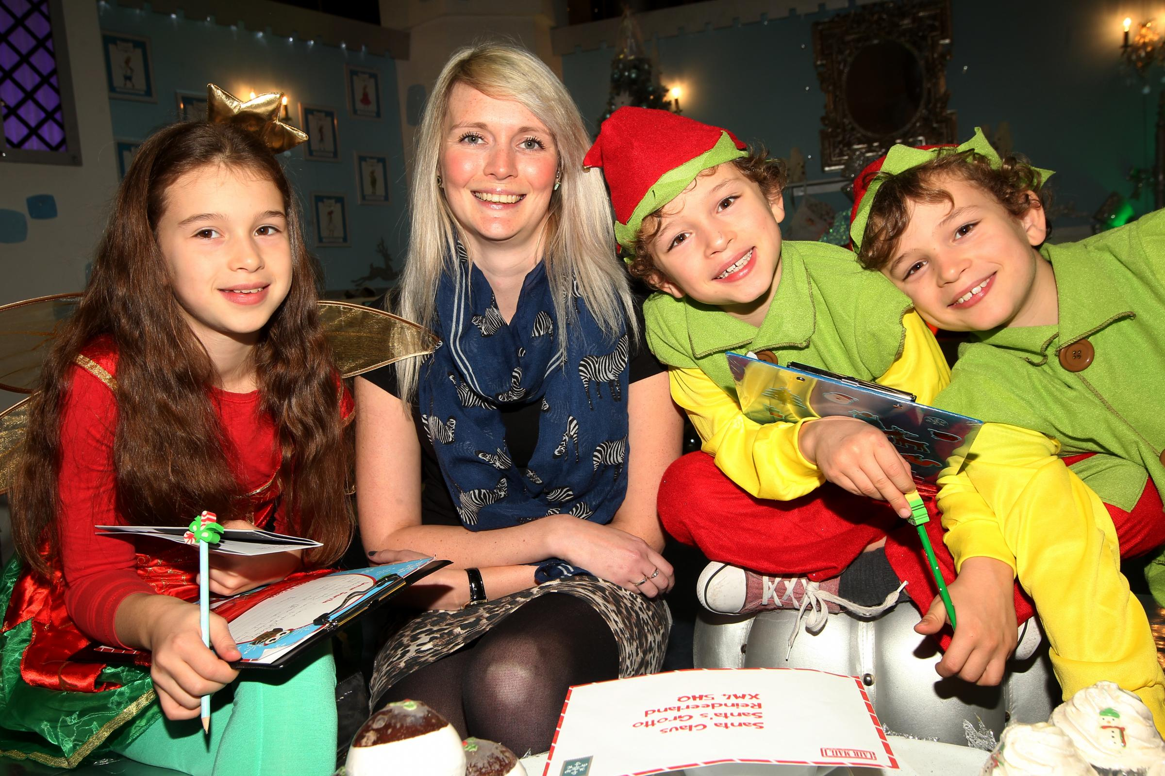 Clare Elgar receives present advice from the Slatcher-Ball children, from left, Megan, nine, and twins Callum and Oliver, seven