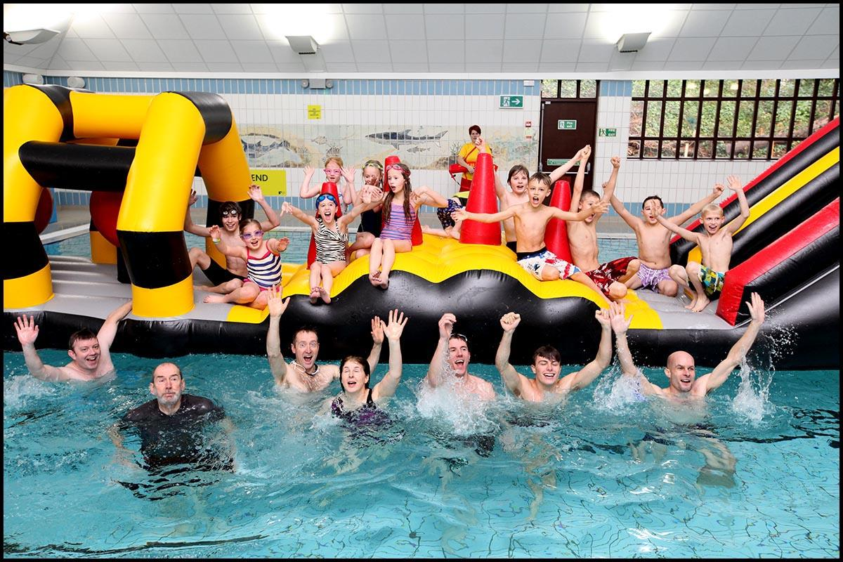 Celebration as once-threatened community pool reopens
