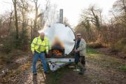 Pondhead Conservation Trust volunteers Derek Tibbetts and Dave Dibden with the group's charcoal burner.