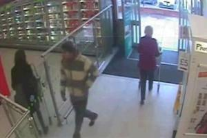 Hunt for couple who stole £200-worth of booze from supermarket