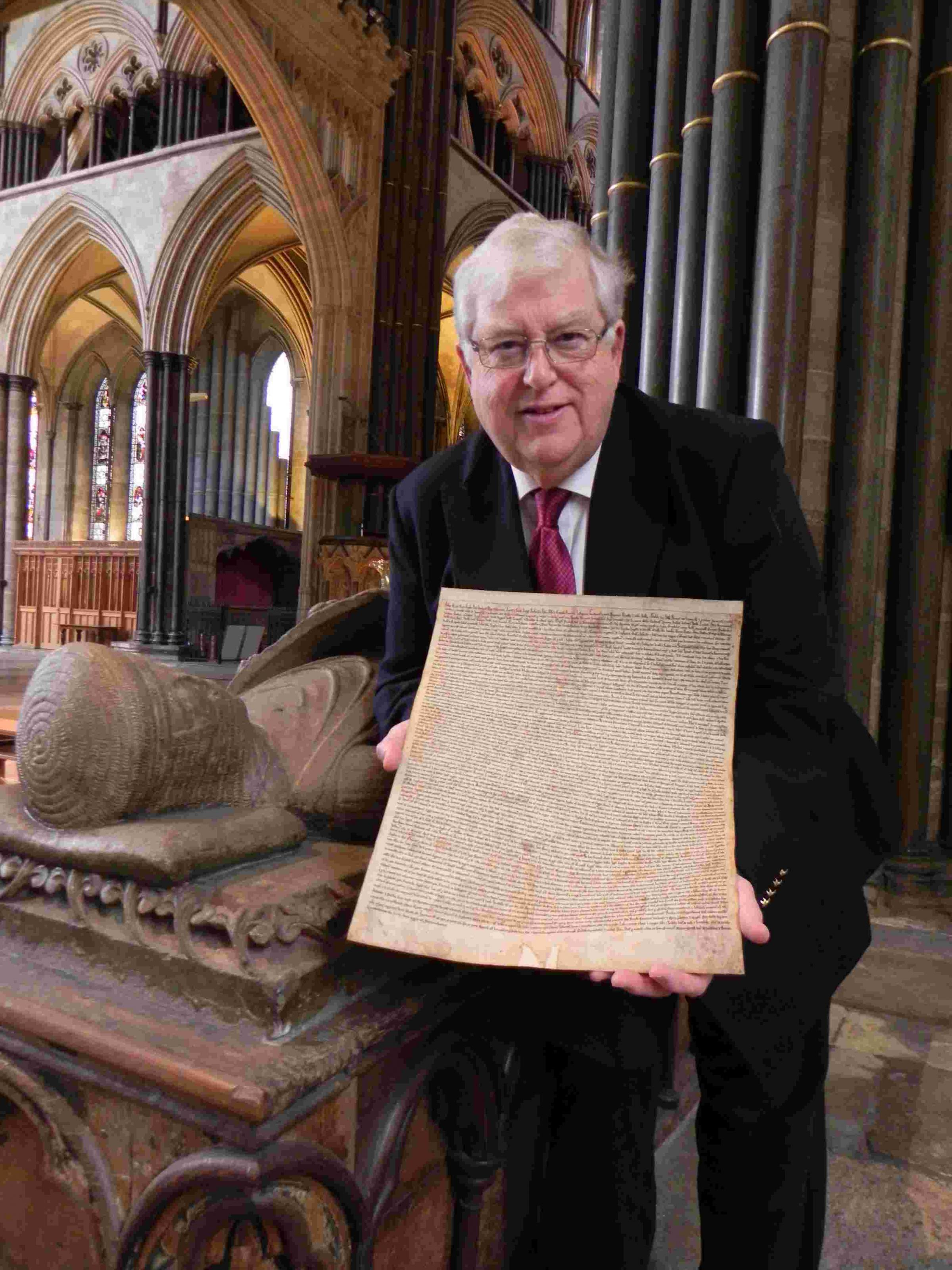 Robert Key at Salisbury Cathedral with the Magna Carta facsimile at the tomb of William Longspee, half brother of King John, who was at Runnymede on June 15, 1215