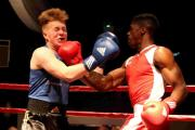 Golden Ring's Tyrone Gordon, right, connects with a vicious uppercut on route to a stoppage win over Sam Carey