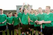 Team captain Jack Pearson holds the Peter Munro Cup aloft after Barton Peveril's victory over Andover