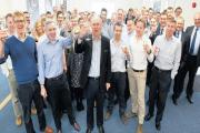 Cheers! BMT Nigel Gee MD John Bonafoux, second left front, chairman Gary Smith, centre, and staff at the announcement of expansion plans and celebrating their new office