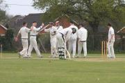James Woolgar, second left, celebrates a wicket for Lymington against Fawley.