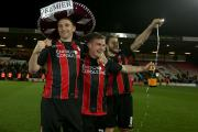 Bournemouth players celebrate their promotion
