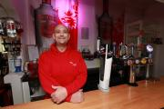 Landlord Jason Palmer behind the bar of The Angel