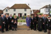 Group photo shows Cdr Unwin's family on the left hand side and distinguished guests on the right at the VC commemoration event. The Victoria Cross commemorative stone tribute to Cdr Edward Unwin at the Promenade in Hythe.