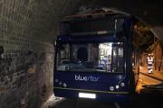 Roof ripped off bus as it crashes into bridge