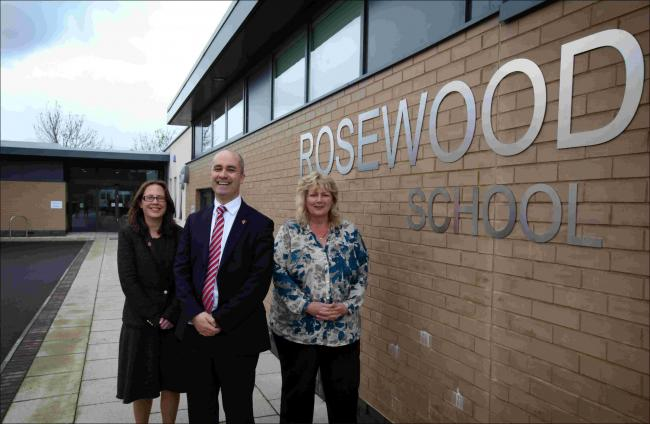 Above, Rosewood headteacher Jenny Boyd, right, who has been made an MBE, with Regional Schools Commissioner for the South- East Dominic Herrington and director of the New Schools Network Natalie Evans.