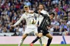 Real Madrid's Toni Kroos vies with new Saints' signing Juanmi Jiménez