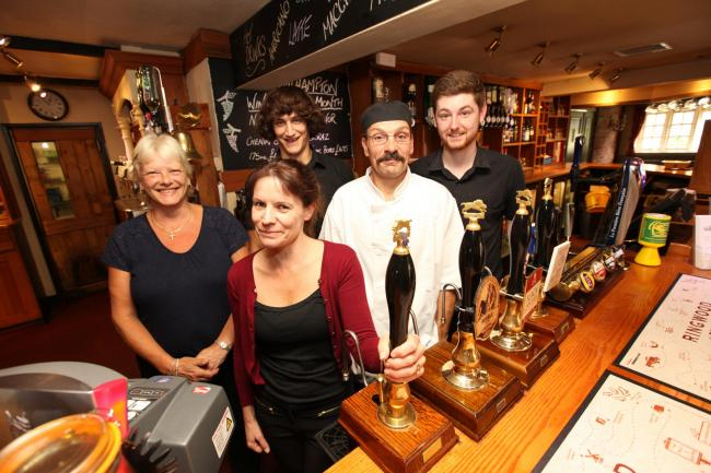Staff behind the bar at The Walhampton Arms