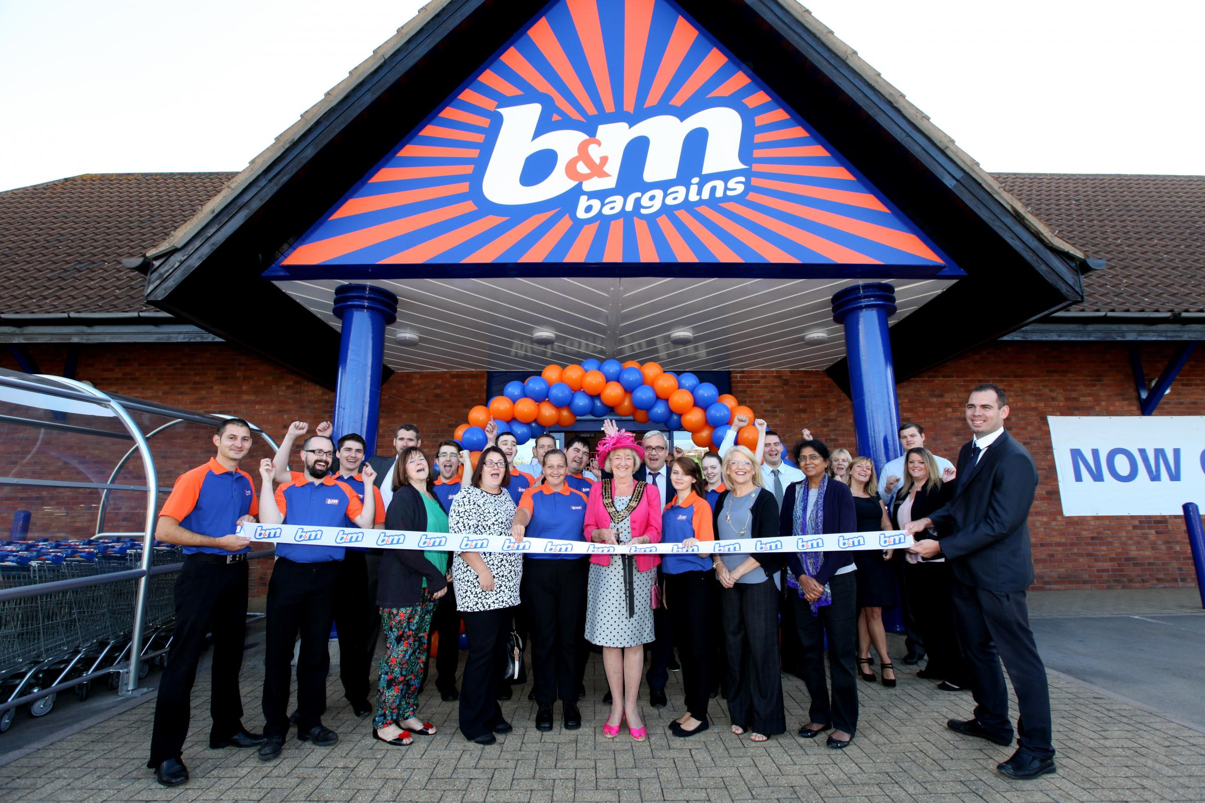 Opening of new B&M Bargains store in Millbrook - Mayor of Southampton Cllr Linda Norris cuts a ribbon to open the store alongside members of The Rainbow Project charity.